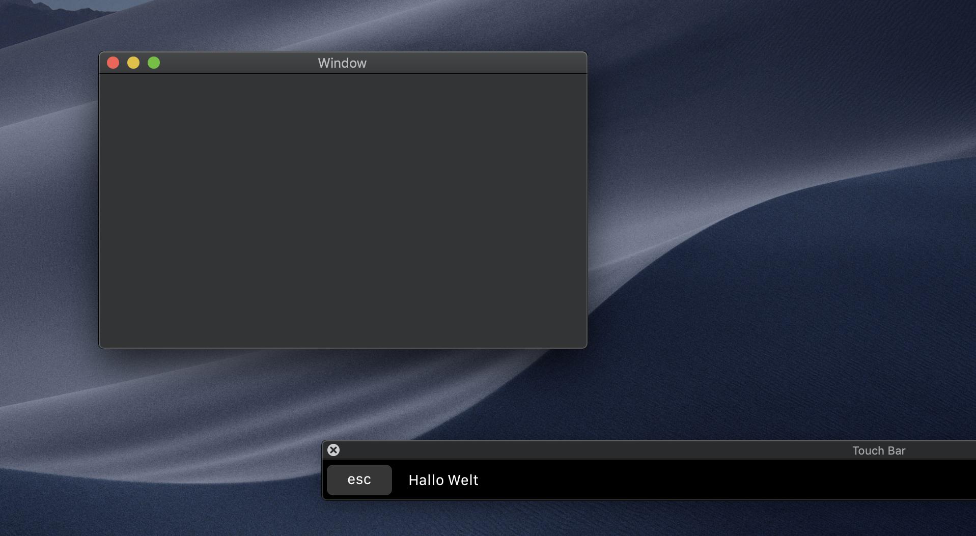 Die Touch Bar zeigt den von uns im Storyboard hinzugefügten Text bei Ausführung der Beispiel-App an.